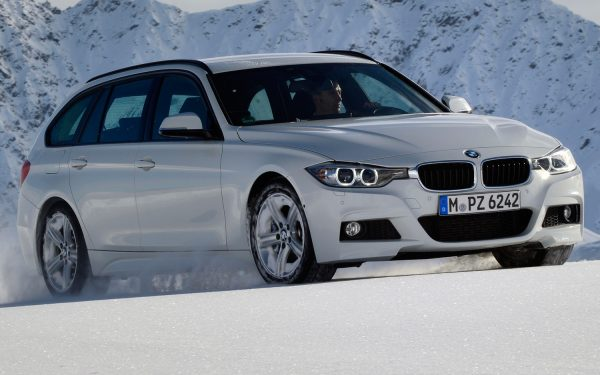 BMW-320d-xDrive-Touring-Euro-Spec-front-side-view[1]