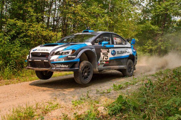 david-higgins-and-codriver-craig-drew-lift-off-in-their-2015-subaru-wrx-sti-at-the-ojibwe-forest-rally-11