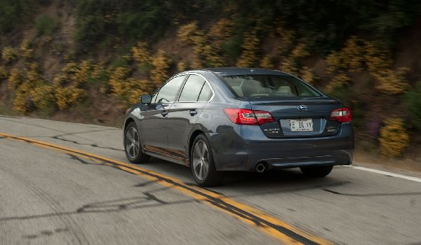 2015-subaru-legacy-25i-limited-rear-side-view-in-motion1